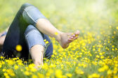 Woman lying in meadow relaxing — Stock Photo