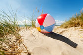 Beach ball in sand dune — Stock Photo