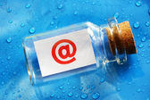 E-mail  symbol message in a bottle — Stock Photo