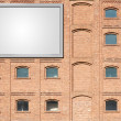 Billboard on a building — Stock Photo