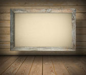 Old board on wooden wall — Stock Photo