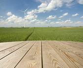 Empty wooden table on the wind-farm — Stock Photo