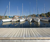Wooden jetty in marina — Stock Photo