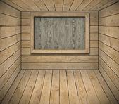 Blackboard on wooden wall — Stock Photo