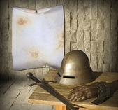 Knight armor and advertisement — Stock Photo
