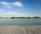 Wooden jetty and yacht — Stock Photo