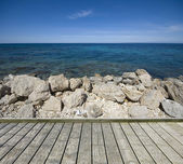 Jetty with stony coast — Stock Photo