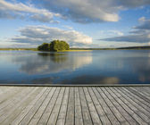 Empty jetty and small island — Stock Photo