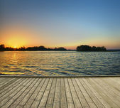 Jetty and lake after sunrise — Stock Photo