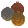 Three medals for prize-winning places — Stock Photo