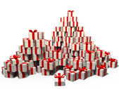 It is a lot of gifts by a holiday in white boxes with a red tape — Stock Photo