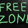 """Free zone"" handwritten with white chalk on a blackboard — Stock Photo"