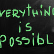 Everything is possible handwritten with white chalk on a black — Stock Photo