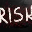 "Stock Photo: ""Risk"" handwritten with white chalk on blackboard"