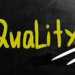 """Quality"" handwritten with white chalk on a blackboard — Stock Photo"