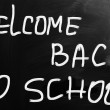 """""""Welcome back to school"""" handwritten with white chalk on a black — Stock Photo"""
