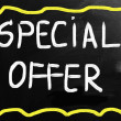 """Special offer"" handwritten with white chalk on a blackboard — Stock Photo"