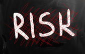 """Risk"" handwritten with white chalk on a blackboard — Foto Stock"