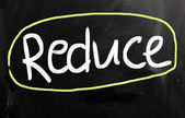 """Reduce"" handwritten with white chalk on a blackboard — Stock Photo"