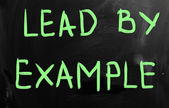 """Lead by example"" handwritten with white chalk on a blackboard — Stock Photo"
