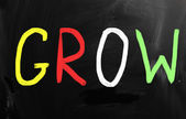 """Grow"" handwritten with white chalk on a blackboard — Stock Photo"