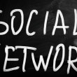 The word Social network handwritten with white chalk on a blac — Stock Photo