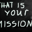 "Stock Photo: ""What is your mission "" handwritten with white chalk on blackb"