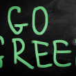 """Go green"" handwritten with white chalk on a blackboard — Zdjęcie stockowe"