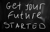 """Get your future started"" handwritten with white chalk on a blac — Foto Stock"