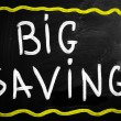 Big savings handwritten with white chalk on a blackboard — Stock Photo