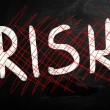 """Risk"" handwritten with white chalk on a blackboard — Stock Photo #28200909"