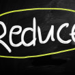 """Reduce"" handwritten with white chalk on blackboard — Stock Photo #28201267"