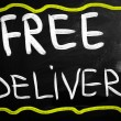 """Free delivery"" handwritten with white chalk on a blackboard — Stock Photo"