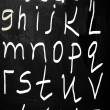 Stock Photo: Complete english alphabet handwritten with white chalk on blac