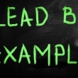 """""""Lead by example"""" handwritten with white chalk on a blackboard — Stock Photo"""