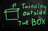 """Think outside the box"" handwritten with white chalk on a blackb — Stock Photo"