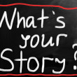 """What is your story"" handwritten with white chalk on a blackboar — Stockfoto #28536147"
