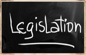 """Legislation"" handwritten with white chalk on a blackboard — Stock Photo"
