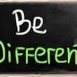 Stock Photo: Be different handwritten with chalk on a blackboard
