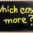 """Which costs more?"" handwritten with chalk on a blackboard — Stock Photo"