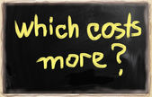 """Which costs more?"" handwritten with chalk on a blackboard — Stockfoto"