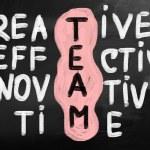 """""""Team"""" handwritten with white chalk on a blackboard — Photo"""