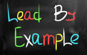 """Lead by example"" handwritten with chalk on a blackboard — ストック写真"