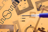 RFID implantation syringe and RFID tags — Stock Photo