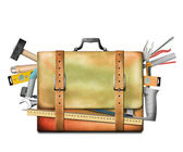 Briefcase and tool — Stock Photo