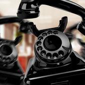 Black vintage telephone on a white background — Stock Photo