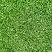 Green grass, artificial football coverage — Stock Photo
