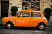 Retro car orange — Stockfoto