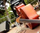 Cello and musical instruments — Stock Photo