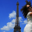 Beautiful young woman on the Eiffel tower — Stock Photo #51467453